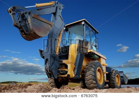 Rear View Of  Loader Excavator With Rised Backhoe