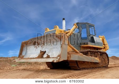 Heavy Bulldozer With Half Raised Blade In Sandpit