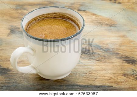 cup of fresh fatty coffee with butter and coconut oil - ketogenic diet concept
