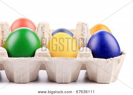 Colourful easter eggs in box.