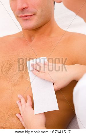Man Waxing His Chest Hair