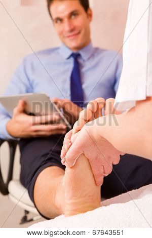 Businessman Receiving Foot Massage From Therapist