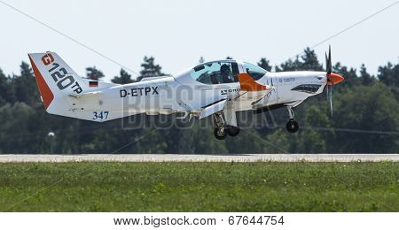 BERLIN, GERMANY - MAY 20, 2014: Two seated training and aerobatic low-wing aircraft Grob G120 TR (Germany), demonstration during the International Aerospace Exhibition ILA Berlin Air Show.