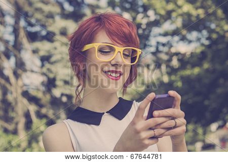Hipster girl texting. Retro styled imagery