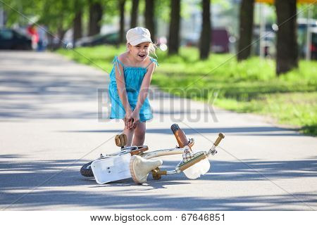 Girl With Pain In Leg After Falling Down From Bicycle
