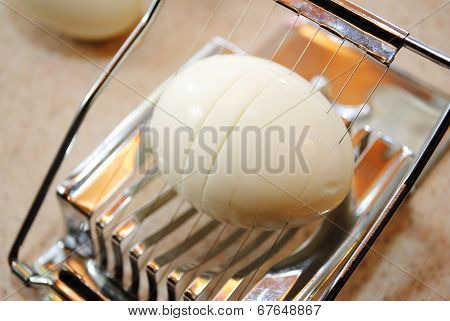 A Sliver Whole Egg Slicer With An Egg