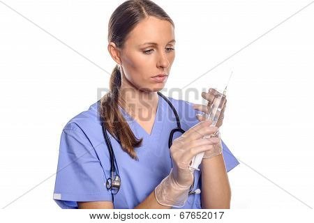 Nurse Or Doctor Holding A Large Hypodermic Syringe