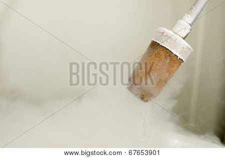 closeup of a transfer of liquid nitrogen