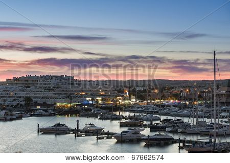 Luxurious Yachts Docked In The Marina Of Vilamoura, Portugal