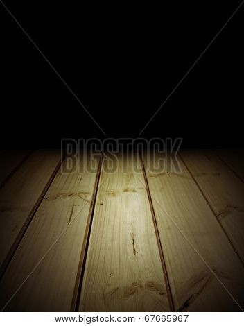 Wooden floorboards and black wall