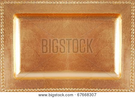 golden empty plate surface texture