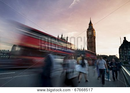 Slow motion blurred tourists and and traffic on Westminster Bridge with Big Ben in background, London.
