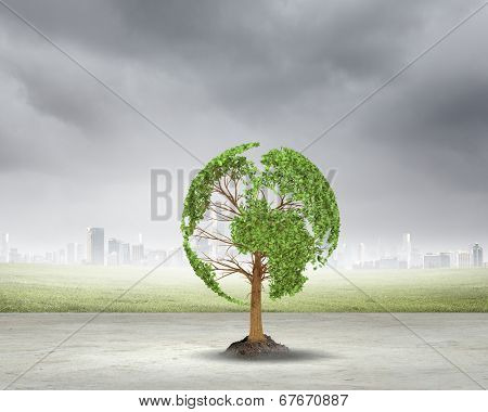 Green tree shaped liked our Earth planet. Environmental concept