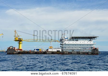 barge and tug boat in open sea