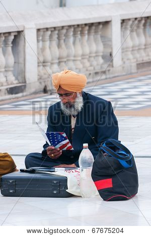 Sikh Emigrant, Sitting On The Pavement.