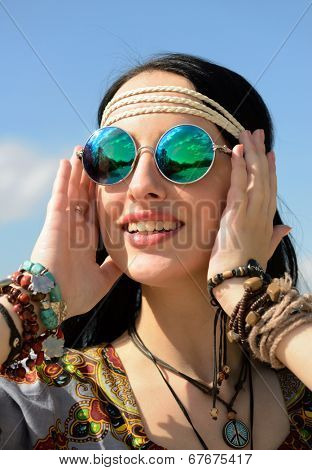 hippie girl in mirrored sunglasses