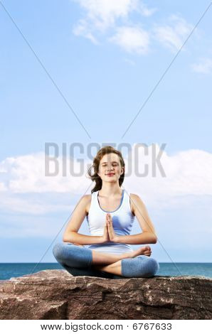 Young Girl Meditating Outdoors