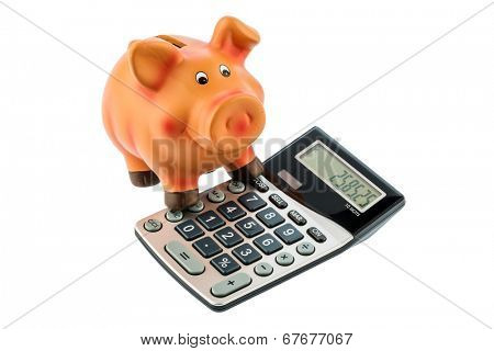a calculator beside a piggy bank. profitability of the investment. interest for savers