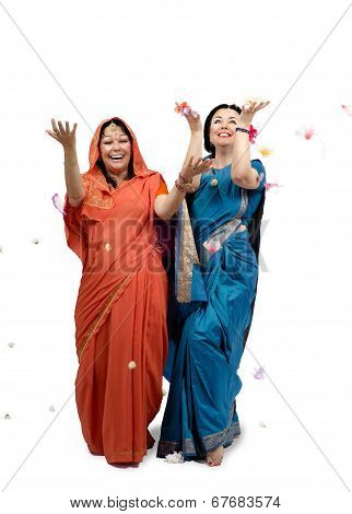 Women In Sari Under Rain Of Flowers