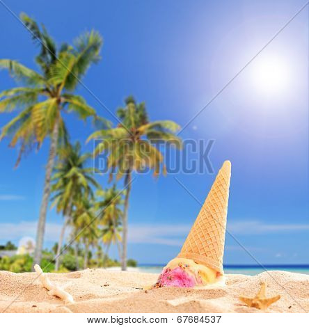 Ice cream thrown in the sand on a tropical beach with the focus on the ice cream shot with tilt and shift lens
