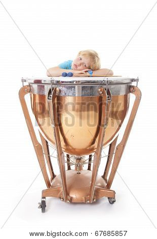 Young Boy Resting On His Arms On Kettledrum