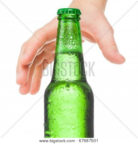 Male Hand Trying To Reach Bottle Of Beer - Studio Shot Over A White Background