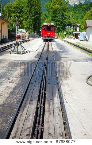 Diesel Locomotive On A Vintage Cogwheel Railway Going To Schafberg Peak