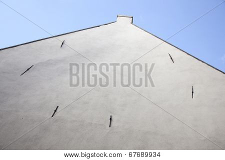 Facade Of Old House With White Stucco Without Windows