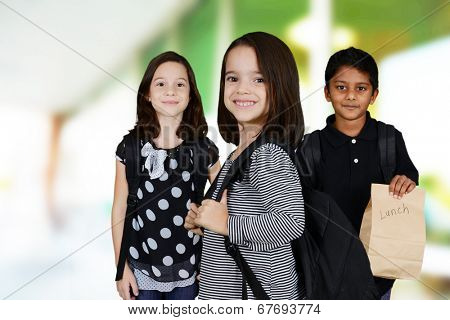 Students at school with their backpacks and lunch