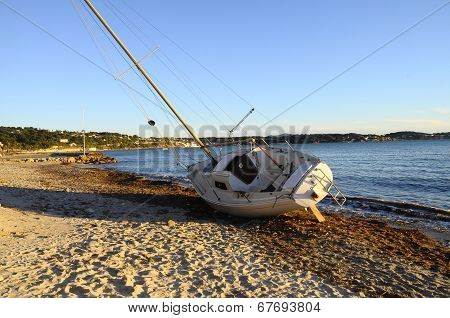 Sailboat Boat Stranded On The Beach After A Storm