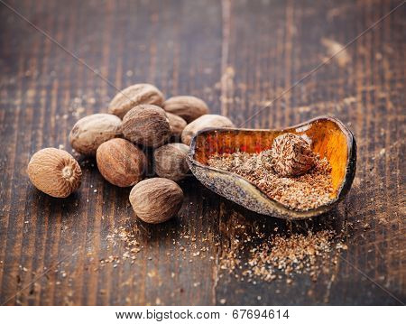 Grated Nutmeg On Dark Wooden Background