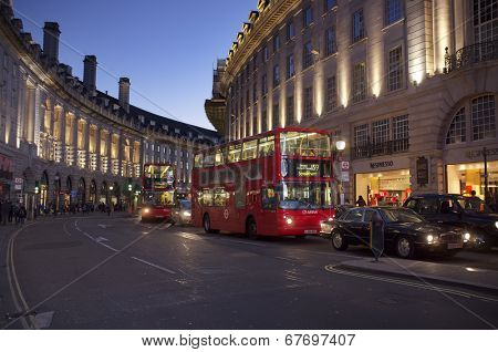 LONDON, UK - APRIL 16, 2014: Regent Street at Piccadilly Circus with red doubledecker buses.