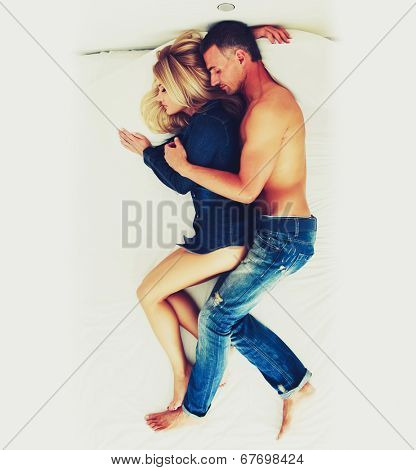 Top view of a couple sleeping together on the bed