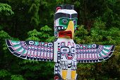stock photo of totem pole  - Totem poles are monumental sculptures carved from large trees - JPG