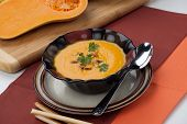 foto of butternut  - Hot delicious pumpkin soup in a bowl - JPG