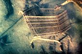 picture of discard  - Abstract creative photo of shopping trolley discarded on the sea bottom - JPG