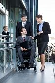 stock photo of disable  - Vertical view of disabled worker and his co - JPG