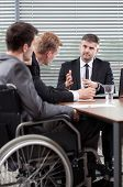 foto of disable  - Disabled employee next to conference table vertical - JPG