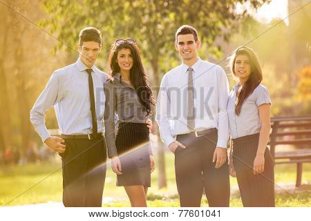 Business Team In The Park