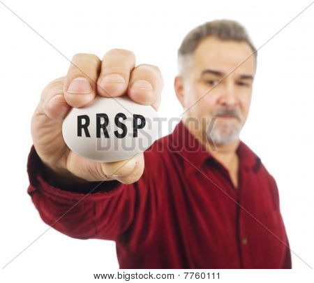 RRSP written on white nest egg held by mature man.