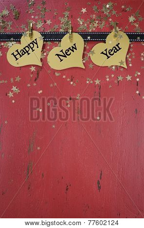 Happy New Year Background With Hanging Hanging With Sample Text On Red Rustic Distressed Vintage Woo