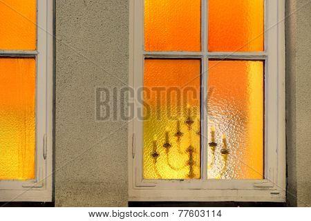 Candlestick Seen Through Window