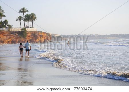Retired couple on a misty summer beach