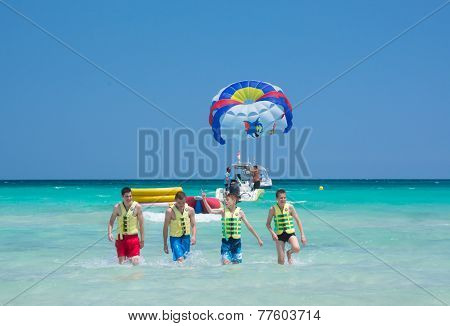 Four Happy Parasailers