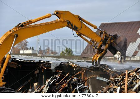 loader demolishes an old building
