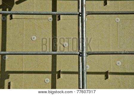 House Wall With Insulation Material Rock Wool And Scaffold