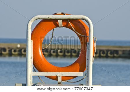Orange Life Buoy Ring Life Belt In Port