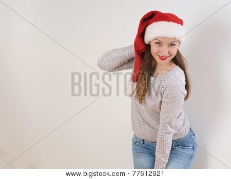 Smiling Young Woman In Santa Hat On White Background