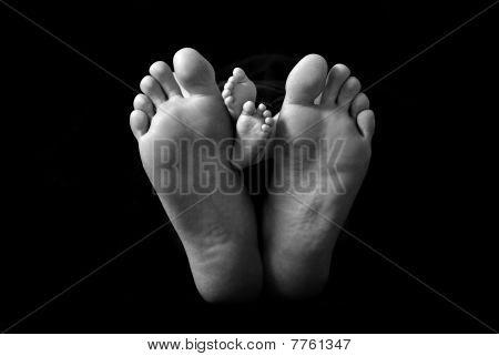 Dad And Baby's Feet