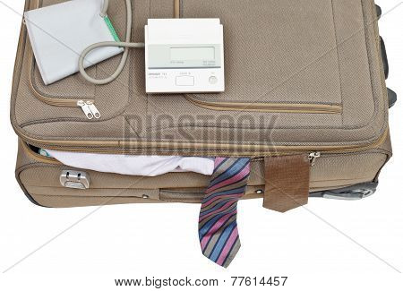 Blood Pressure Monitor On Suitcase With Male Ties
